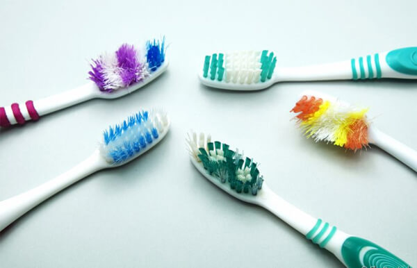 tipos de cerdas escovas de dentes